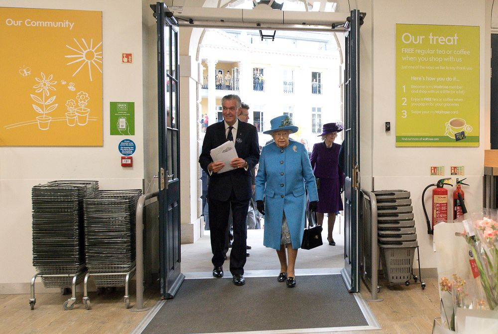 POUNDBURY, ENGLAND - OCTOBER 27:  Queen Elizabeth II arrives to look around a Waitrose supermarket during a visit to the town of Poundbury on October 27, 2016 in Poundbury, Dorset. Poundbury is an experimental new town on the outskirts of Dorchester in southwest England designed with traditional urban principles championed by The Prince of Wales and built on land owned by the Duchy of Cornwall. (Photo by Justin Tallis - WPA Pool/Getty Images)