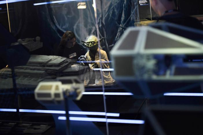 Lucas Museum of Narrative Art (LMNA) registrar Kathy Smeaton, from San Rafael, helps unpack the Yoda puppet used in the original movies, at the Star Wars Identities exhibition at the 02 in London, Britain, November 8, 2016.  REUTERS/Dylan Martinez